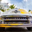 Stock Photo: Classic Oldsmobile with chrome radiator grill parked in front o