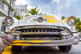 Classic Oldsmobile with chrome radiator grill parked in front o — Stock Photo
