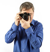 Man takes a picture with an old analog camera — Stock Photo