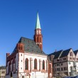 Постер, плакат: Old Nikolai Church in Frankfurt at the central roemer place