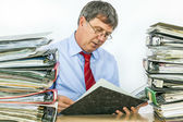 Man studies folder with files at his desk in the office — Stock Photo
