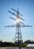 Landscape with electric masts in sunshine — Stock Photo