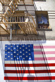 Stars and stripes at a house wall in San Francisco — Stock Photo
