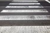 Old rotten pedestrian crossing stripes  — Stock Photo