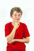 Happy boy with red shirt thinks — Stock Photo