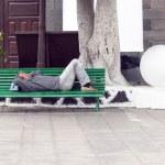 ARRECIFE, SPAIN - APRIL 3: man holds a siesta on a bench  — Stock Photo #41903235