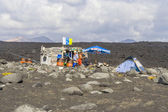 People at a fishermans hut  at volcanic beach in Timanfaya — Stock Photo