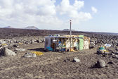 Fishermans hut  at volcanic beach in Timanfaya — Stock Photo