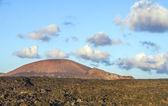 Vulcanic landscape under the extincted vulcano — Stock Photo