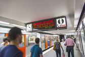 People in the metro station with train in motion — Stock Photo