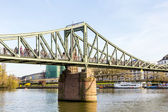People at bridge eiserner steg in Frankfurt with river Main — Stock Photo