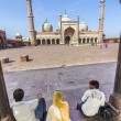 Family rests in Jama Masjid Mosque, old Delhi, India. — Stock Photo #44128373