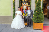 Japanese coupule proudly poses in wedding clothes — Stock Photo