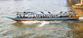People travel in the typical long boat at the river Mae Nam Chao — Stock Photo