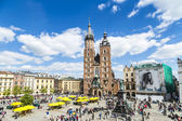Tourists at the Market Square in Krakow — Stock Photo