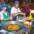 Chef cooks food at a street-side restaurant — 图库照片 #46418445