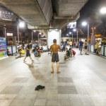 Постер, плакат: Teens perform streetdance in the train station by night