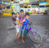Children sitting on a bike early morning — Stock Photo