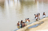 Pilgrims take ritual bathing in holy lake — Stock Photo