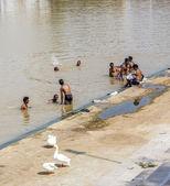 Pilgrims take ritual bathing in holy lake — Stock Photo