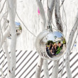 Family is mirroring in Christmas tree balls — Stock Photo #47393793