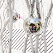 Family is mirroring in Christmas tree balls — Stock Photo #47393841