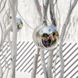 Family is mirroring in Christmas tree balls — Stock Photo #47393891