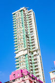 Facade of houses downtown Kowloon with appartments and air condi — Stock Photo