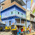 Auto rickshaw three-weeler tuk-tuk taxi transports people in Jo — Stock Photo #47516847