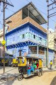 Auto rickshaw  three-weeler tuk-tuk taxi transports people in Jo — Stock Photo