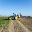 Tractor on field sputtering pest protection — Stock Photo #47592533