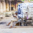 Rickshaw man rests and reads news — Stock Photo #47649665