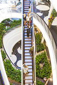 People on moving staircase — Stock Photo