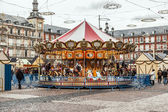 Carousell for children in the evening at the plaza de Mayor in M — Stock Photo