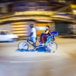 Senior man transport in old tricycle rickshaw a Lady — Stock Photo #47681163
