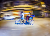 Senior man transport in old tricycle rickshaw a Lady — Stock Photo