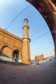 Group of worshipers rest on courtyard of Jama Masjid Mosque in D — Stock Photo