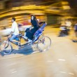 Senior man transport in old tricycle rickshaw a Lady — Stock Photo #47712795