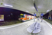 Arriving train  at train station in early morning — Stock Photo
