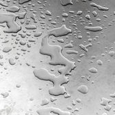 Water on silver metal — Stock Photo