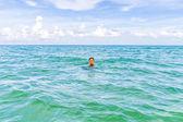 Teenage boy enjoys swimming in the ocean  — Stock Photo