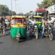 Transporting people through city on auto rickshaw — Stock Photo #48706615