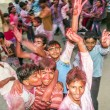 People throw colors to each other during the Holi celebration — Stock Photo #48708061