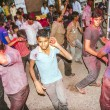 People throw colors to each other during the Holi celebration — Stock Photo #48708095