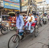 Cycle rickshaws with passenger in the streets — Stok fotoğraf