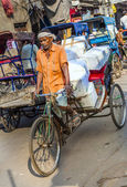 Cycle rickshaws with cargo load in the streets — 图库照片