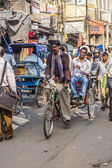 Cycle rickshaws with passenger in the streets — Stock fotografie