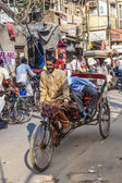 Cycle rickshaws with passenger in the streets — Foto de Stock