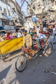 Cycle rickshaws with passenger in the streets — Photo