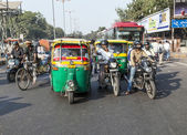 Transporting people through city on auto rickshaw — Stock Photo